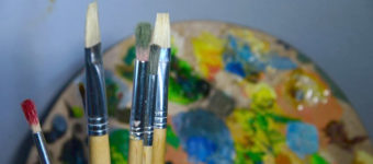 Paintbrushes and oil palette