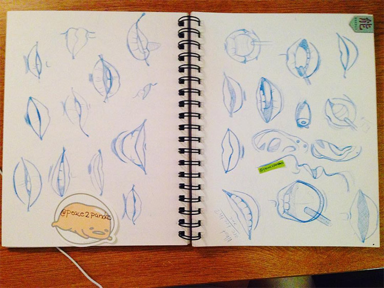 Blue pencil sketches of lips