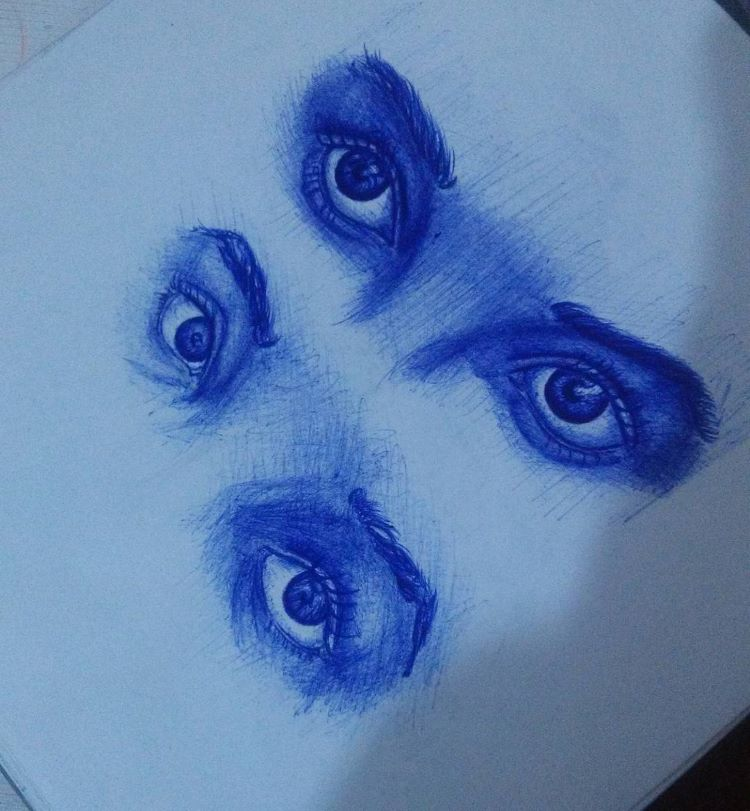 Blue pencil drawings of eyes