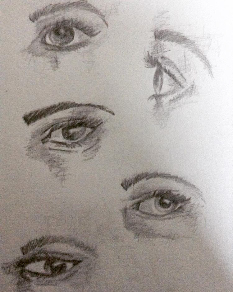 Detailed sketches of human eyes