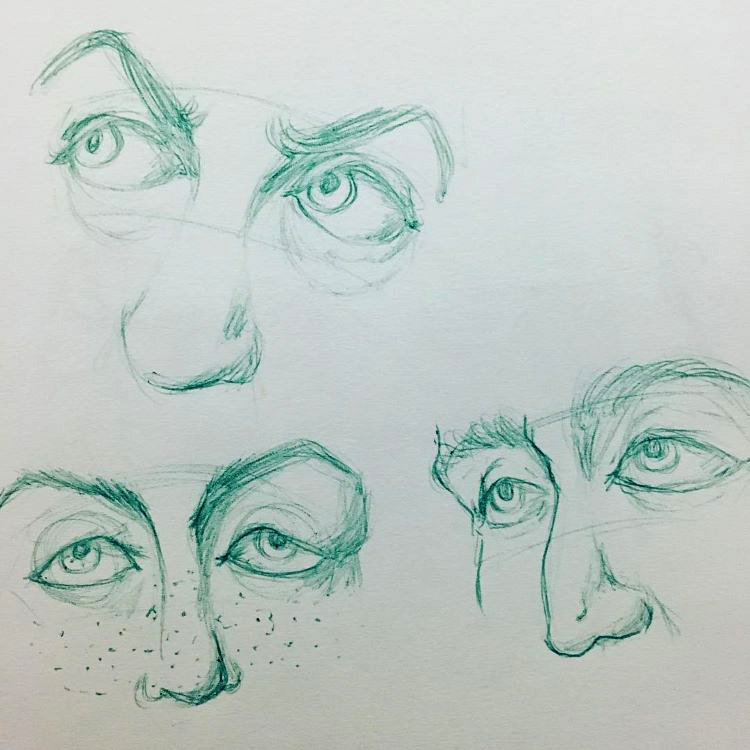Green drawings of eyes