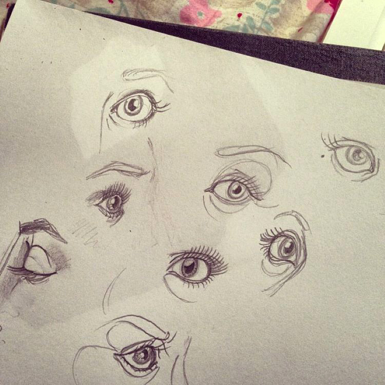 Eye drawings on toned paper