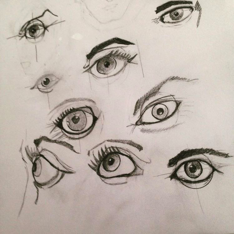 Detailed human eyes drawn on paper