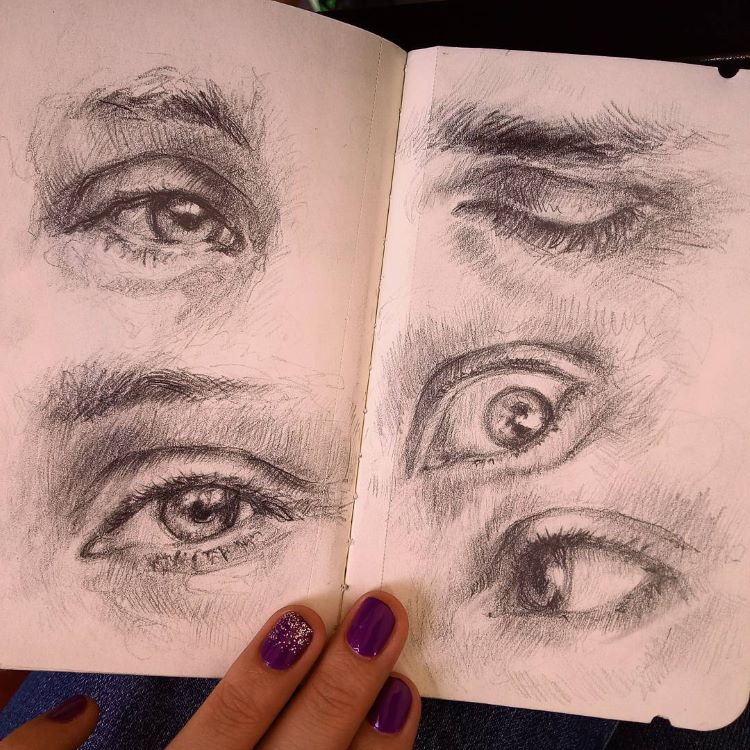 Detailed sketchbook eye drawings