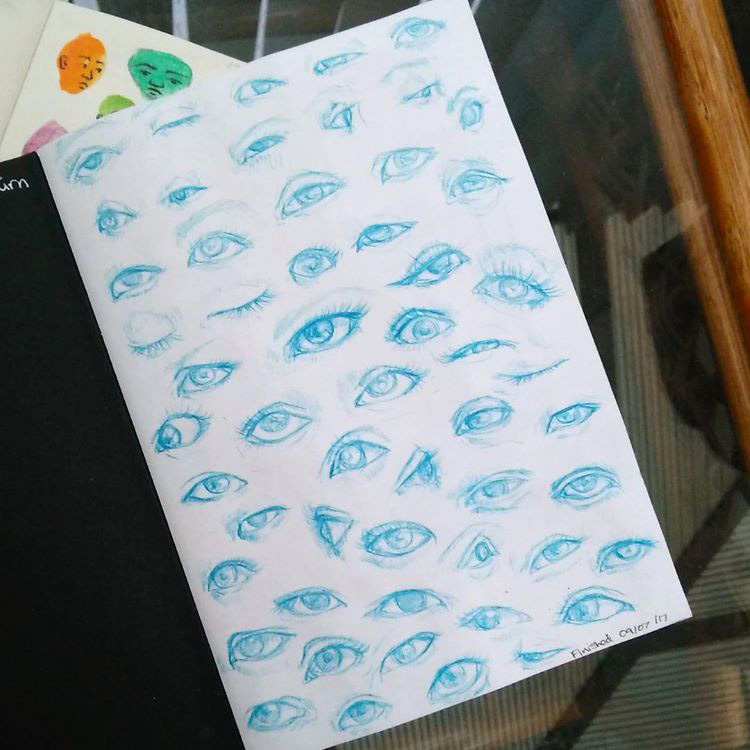 Blue graphite pencil eye drawings