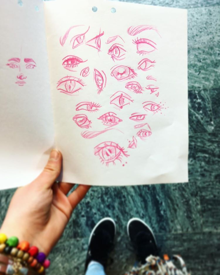 Red pencil sketches of eyes