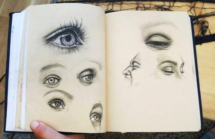 Holding sketchbook with eyes inside