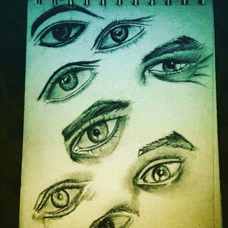 Vertical sketchbook drawing of eyes