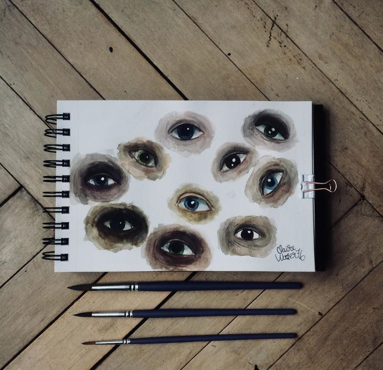 Various watercolor eyes in different shades