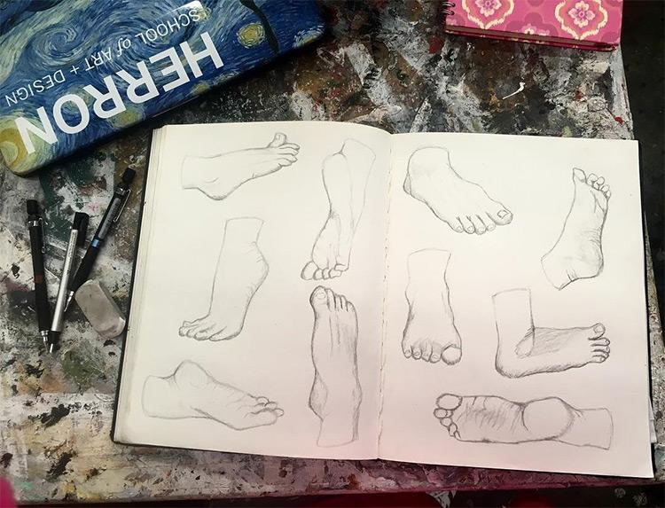 Light sketchbook drawings of feet