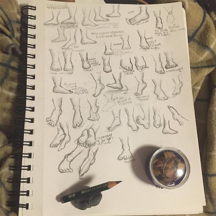 Drawings of random feet in sketchbook