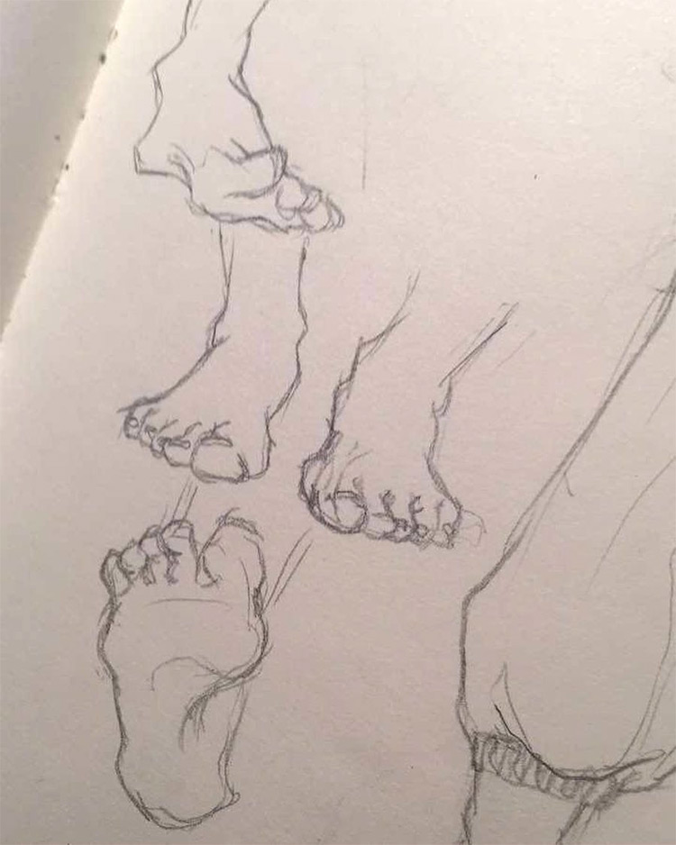 Various drawings of feet in sketchbook