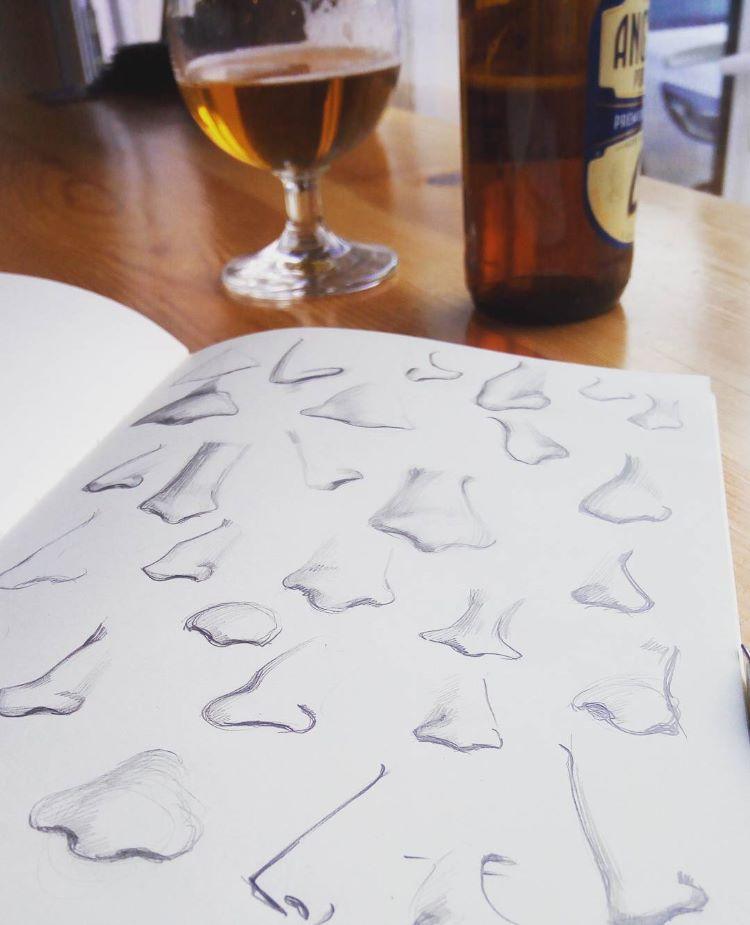 Simplified nose drawings in sketchbook