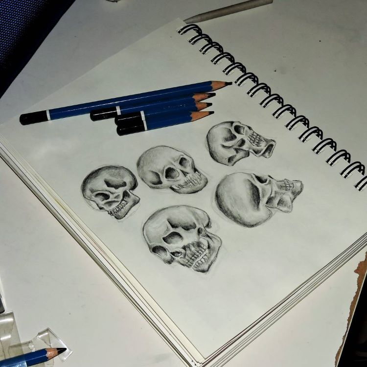 Rough skull sketches in notebook