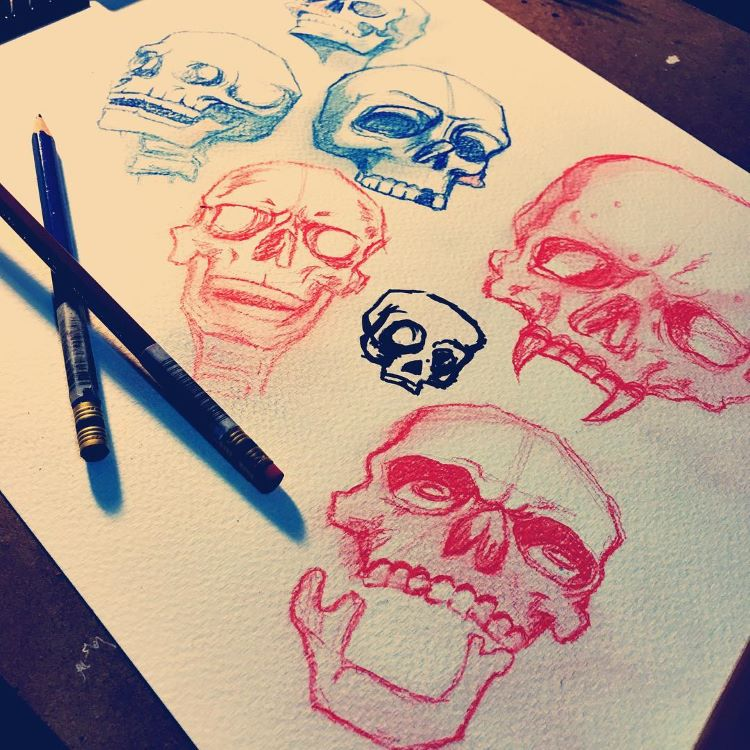 Red and blue pencil drawings of skulls